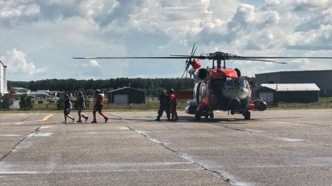 Five rescued by U S  Coast Guard after aircraft collision on